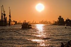 Golden hour in Hamburg. Port of Hamburg during sunset Stock Images