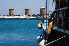 Port. Harbor with windmills on the Rhodes Royalty Free Stock Images