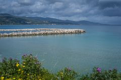 Port and harbour on the Alykes Bay in Zante. With stormy dramatic clouds accumulating in the sky, Greece stock photo