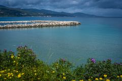 Port and harbour on the Alykes Bay in Zante. With stormy dramatic clouds accumulating in the sky, Greece royalty free stock photos