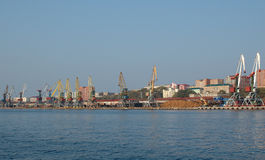 Port (harbour) Vladivostok with lifting crane. Royalty Free Stock Photography