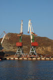 Port (harbour) Vladivostok with lifting crane. Royalty Free Stock Images