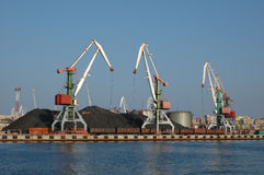 Port (harbour) Vladivostok with lifting crane. Stock Photo