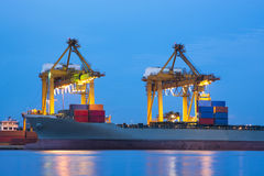 Port with heavy crane on the twilight Royalty Free Stock Images