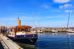 Port of Hel. HEL, POLAND - AUGUST 10, 2015: People walking through in the port on the waterfront with many boat and sailboat in Hel. Hel is one of most famous Royalty Free Stock Images
