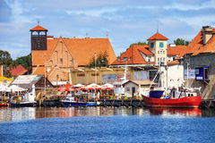 Port of Hel. HEL, POLAND - AUGUST 10, 2015: People walking through in the port on the waterfront with many boat and sailboat in Hel. Hel is one of most famous Stock Photo