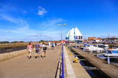 Port of Hel, Poland. HEL, POLAND - AUGUST 10, 2015: People walking through in the port on the waterfront with many boat and sailboat in Hel. Hel is one of most Stock Photo