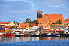 Port of Hel. HEL, POLAND - AUGUST 10, 2015: People walking through in the port on the waterfront with many boat and sailboat in Hel. Hel is one of most famous Royalty Free Stock Photo