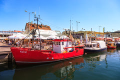 Port of Hel. HEL, POLAND - AUGUST 10, 2015: People walking through in the port on the waterfront with many boat and sailboat in Hel. Hel is one of most famous Royalty Free Stock Photography