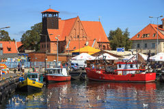 Port of Hel, Poland. People walking through in the port on the waterfront with many boat on August 10, 2015 in Hel, Poland Royalty Free Stock Image