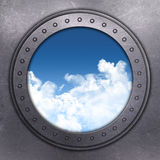 Port Hole looking out onto blue sky Stock Photos