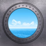 Port Hole looking out onto the ocean Stock Images