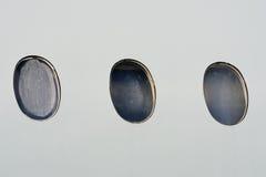 Port holes on aircraft cabin Stock Photos
