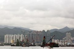 A port of Hong Kong China and shipping containers, buildings and the sea Stock Photo