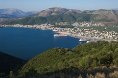 Port of Igoumenitsa. Aerial view of the seacoast and the skyline of Igoumenitsa with ferry boats moored in his commercial harbor Stock Photo
