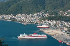 Port of Igoumenitsa. Aerial view of the seacoast and the skyline of Igoumenitsa with ferry boats moored in his commercial harbor Stock Photos