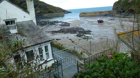 Port Isaac - Cornwall - House Overlooking Harbor - Low Tide. Port Isaac - house overlooking lobster boat in harbor at low tide Royalty Free Stock Photos