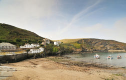 Port Isaac Village, North Cornwall, England. Port Isaac: typical Cornish village with fishing boats in the water, North Cornwall, England, Great Britain Stock Images