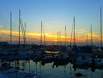 Port of Izola. Sunset over the harbour Stock Photography