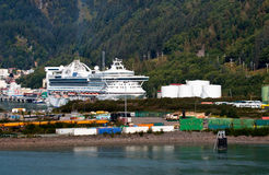 Port of Juneau Alaska. A cruise ships sits in the port of Juneau, capital city of Alaska, surrounded by cargo containers and tanks stock photos