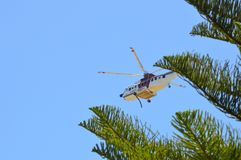Firefighting helicopters drawing water from the local pond in Port Kennedy WA to fight a stock photography
