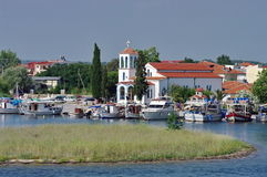 Port city Keramoti and Agios Nikolaos orthodox Church, Greece Royalty Free Stock Images