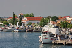 Port city Keramoti and Agios Nikolaos Church, Greece Royalty Free Stock Photos