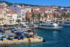 Port of La Maddalena in Italy. Boats, tourists and cars. Stock Photos