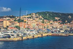 Port of La Maddalena in Italy. Boats, tourists and cars. royalty free stock photography