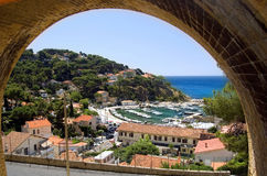 The port La Redonne. View of the port in La Redonne through a bridge arch stock images