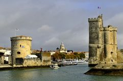 Port of La Rochelle. Old port of La Rochelle in France,tower of the Chaine on the left, tower saint Nicolas on the right Royalty Free Stock Image