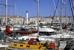 Port of La Rochelle in France. Region Charente-Poitou, with the buildings and lighthouse in the background stock image