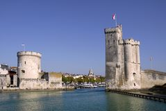 Port of La Rochelle in France. Entry port of La Rochelle in France,tower of the Chaine on the left, tower saint Nicolas on the right Royalty Free Stock Photography