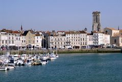 Port of La Rochelle in France. With buildings and a church in the background royalty free stock images