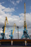Port large cranes. A couple of cranes in the harbor Royalty Free Stock Image