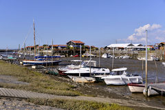 Port of Larros in France. Boats at low tide in the ostreicole harbor of Larros, commune is a located on the shore of Arcachon Bay, in the Gironde department in Stock Image