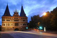 Port Lübecks Holsten Gate at night Royalty Free Stock Image