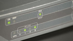 Port leds on a network router. Network router close view with blinking port leds and shallow colors