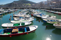 Port of Lekeitio, Bizkaia, Spain. Small pleasure boats in the port of Lekeitio with blue sky, Bizkaia, Basque Country, Spain Royalty Free Stock Image