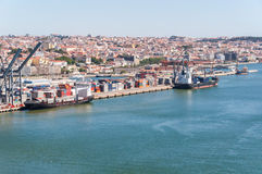 Port of Lisbon in Portugal. Container ships on loading terminal of Lisbon port on Tagus River stock photography