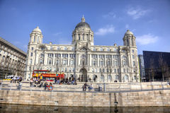 The Port of Liverpool Building. With touring bus and office workers enjoying sunshine during lunch hour Stock Photos