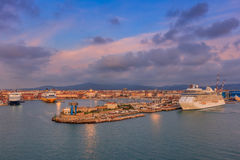 Port of Livorno, Italy. Loading cranes on dockside in port of Livorno, Italy Royalty Free Stock Photo