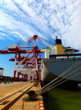 Port with loading cargo ship Stock Images