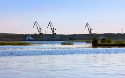 Port With Loading Cranes On The River Bank stock photo