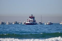 Port of Long Beach Fire department boat with sail boats around. Large port of Long Beach fired department boat surrounded by sail boats and yachts in the ocean royalty free stock photography