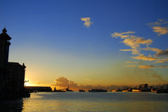 Port-Louis harbour at twilight. View of Port-Louis harbour at sunset Royalty Free Stock Images