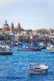 Port and Luzzu in Marsaxlokk, Malta Stock Image