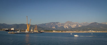 Port of Marina di Carrara. The port of Carrara with the Apuan Alps in background, Tuscany, Italy Royalty Free Stock Images