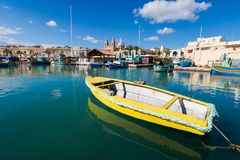 Port in Marsaxlokk on Malta. Colorful touristic landscape of Port in Marsaxlokk on Malta island. Beautiful seascape in south Europe Stock Photo