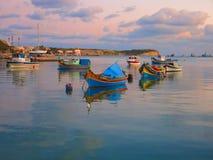Port of Marsaxlokk in Malta. Traditional fishing boats at the port of Marsaxlokk in Malta Royalty Free Stock Photos
